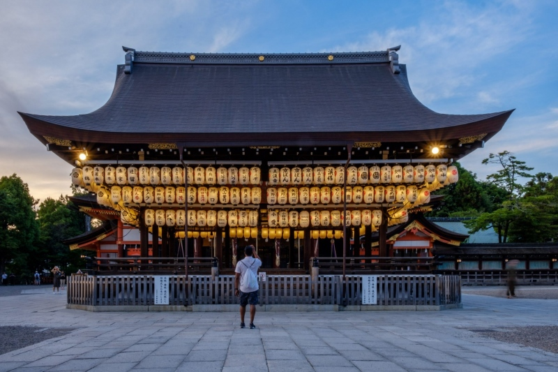 A shrine lights up at dusk, in Kyoto, Japan.