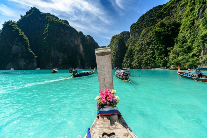 A longtail boat approaches the Phi Phi Islands, in southern Thailand.