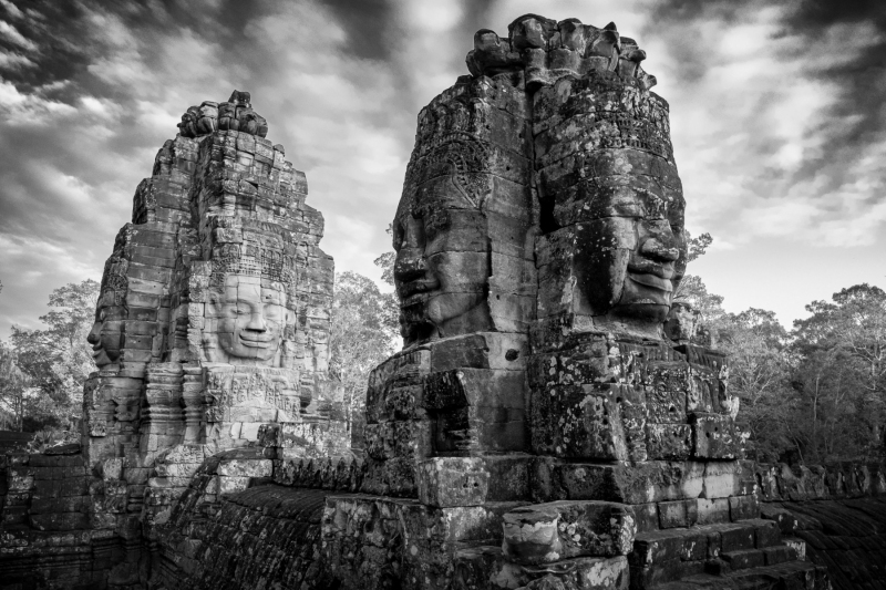 Serene faces carved in stone, at the Bayon Temple, in Angkor Park, Cambodia.