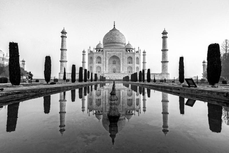 An early morning reflection at the Taj Mahal, Agra, India.