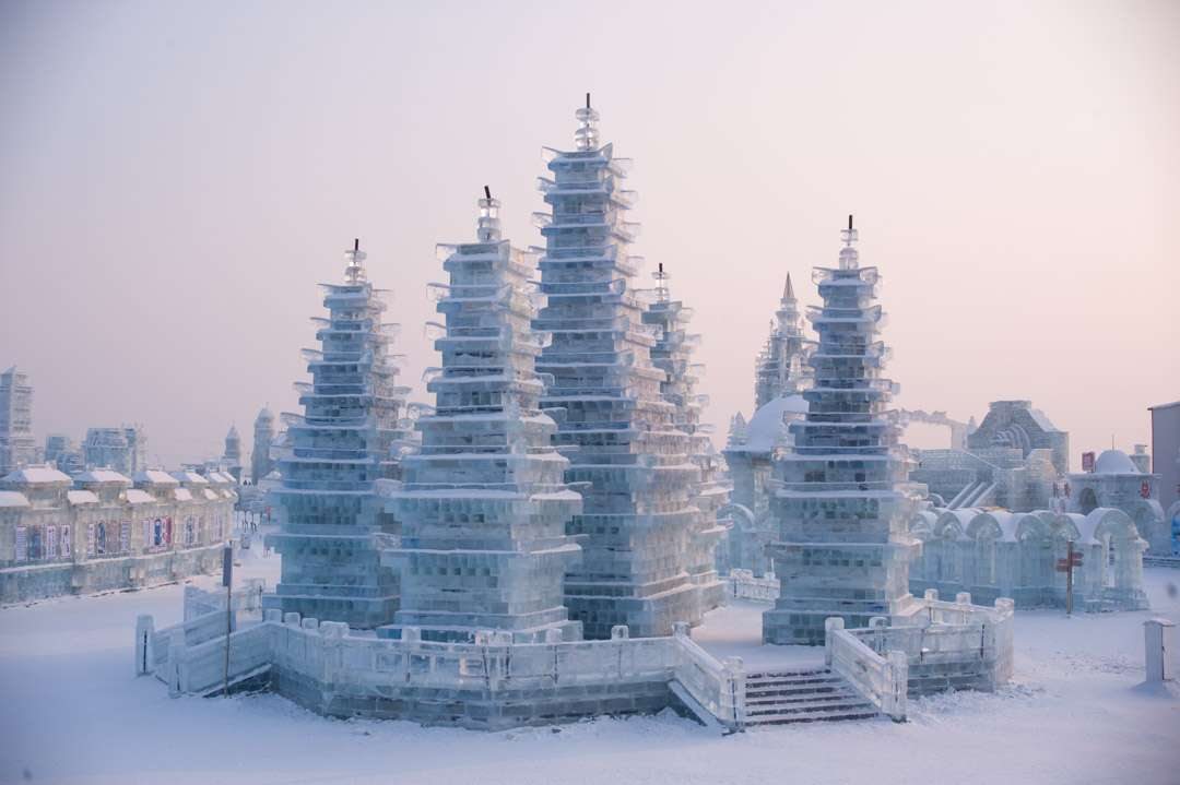 A photo of a white castle built with ice, at the Harbin Ice Festival in China.