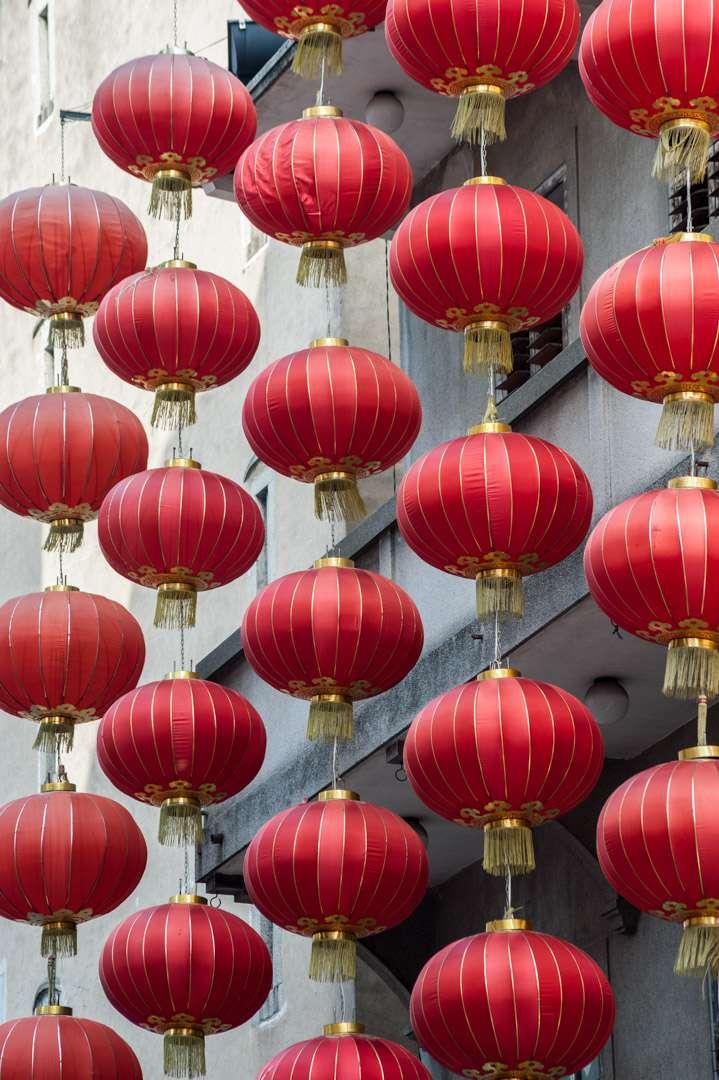 A photo of red lanterns hanging in Macau, China.